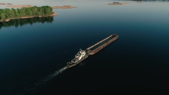 Thumbnail for Aerial Drone footage.Fly Over Barge in Calm Water