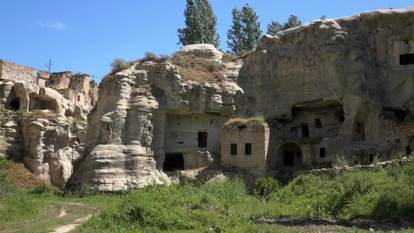 Thumbnail for Fooage. Abanoned Houses in Rocks. Handheld Camera