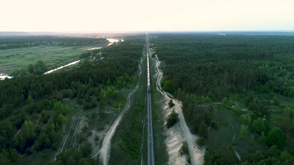 Thumbnail for Aerial Drone Footageof the Train Going to Meet the Camera through the Forest