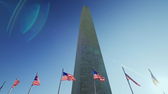 Thumbnail for The Washington Monument, a Sunny Flare From the Flag That Flutters in the Wind