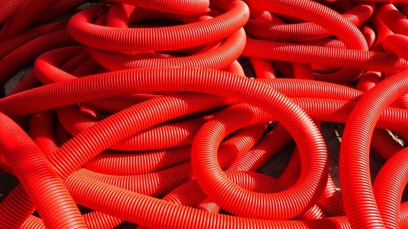 Thumbnail for Industrial Background. Plastic Corrugated Pipes, Drainage in the Roll, . Red Tubes or Pipeline
