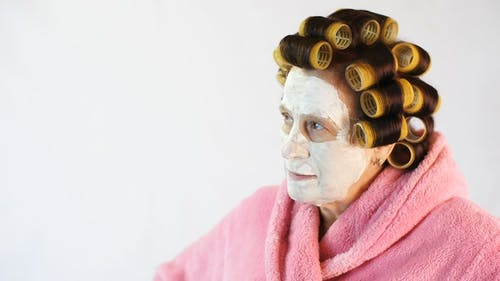 Wicked Wife with a Cosmetic Mask and Curlers