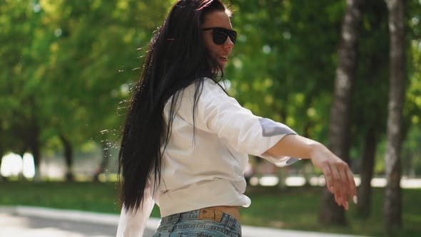 Thumbnail for Sexy Beautiful Brunette Dancing on a Segway in Short Wool and Looking at the Camera