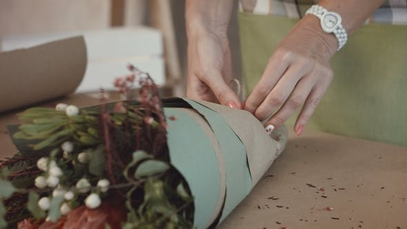Thumbnail for Florist Packing Festive Bouquet in Wrapping Paper