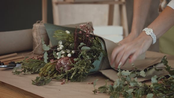 Thumbnail for Florist Wrapping Flower Bouquet in Kraft Paper