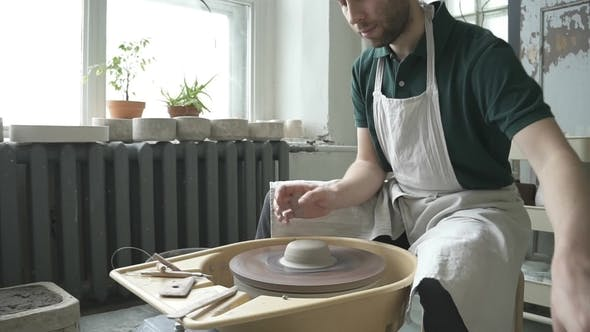 Thumbnail for Portrait of Male Ceramist, Who Is Woking in His Bright Studio.