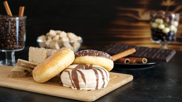 Thumbnail for Donuts and Waffles on Wooden Board with Other Sweets in the Background