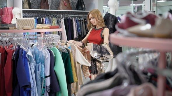 Thumbnail for Pretty Female Choosing Clothes