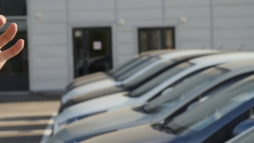 Keys on the Background of a Row of Cars