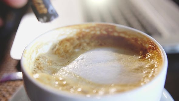 Thumbnail for Mixing Organic Sugars Into a Cup of Latte Coffee, .