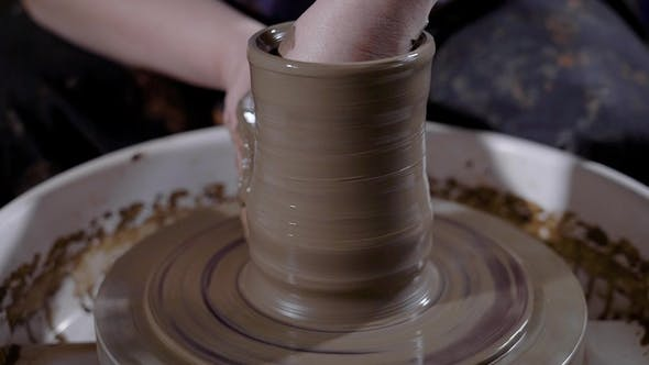 Thumbnail for Crop Hands of Talented Potter Shaping Earthenware and Creating Masterpiece on Potter's Wheel in