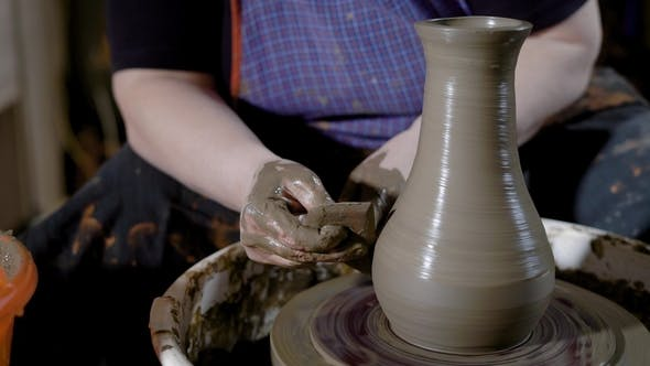 Thumbnail for Crop Hands of Talented Potter Shaping Beautiful Jug on Potter's Wheel in Craft Studio