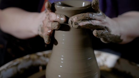 Thumbnail for Crop Strong Hands of Talented Master Shaping Clayware on Potter's Wheel in Workshop