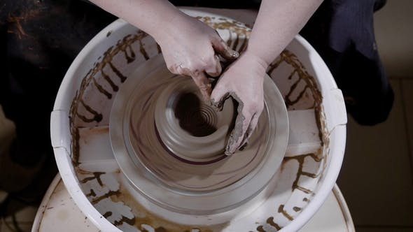 Thumbnail for From Below of Crop Hands of Talented Artisan Creating Masterpiece on Potter's Wheel in Workshop