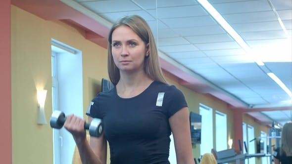 Thumbnail for Woman Doing a Workout with Dumbbells at the Gym