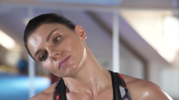 Thumbnail for Beautiful Female Warm-up Training, Stretching Neck in Fitness Studio