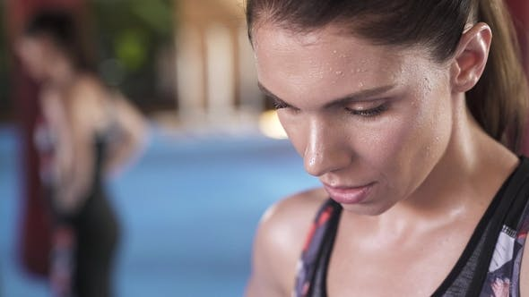 Thumbnail for View of a Athletic Woman with Her Head Down While She Is Breathing Heavily
