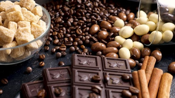 Thumbnail for Overturned Glass with Coffee Beans and Peanuts in Chocolate