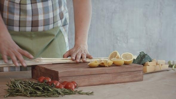 Thumbnail for Female Hands Pinning Slices of Lemon on Skewers