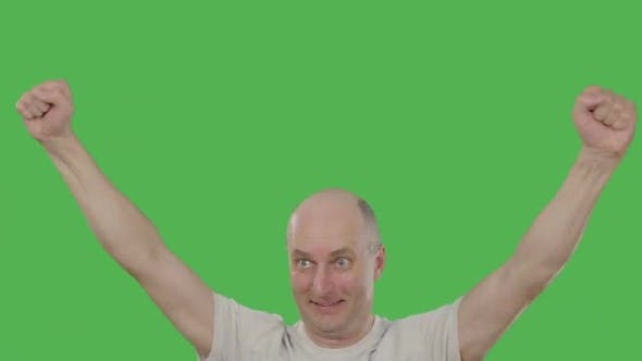 Thumbnail for Man Football Fan Raising Hands up while Watching Soccer Match on Green Background