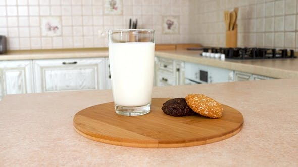 Thumbnail for of a Glass of Milk with Healthy Home Made Multy Cereal Biscuits.