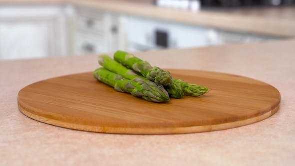 Thumbnail for Heap of Fresh Green Asparagus on the Plate.