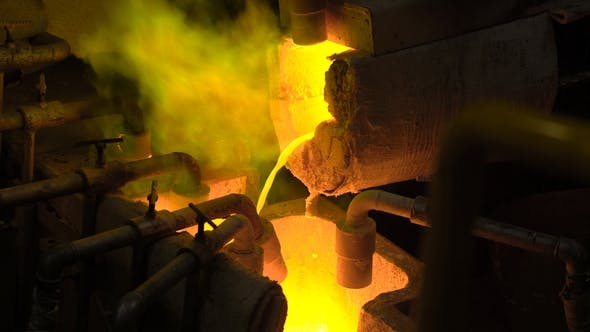 Thumbnail for Metallurgical Production. The Molten Metal Is Pouring From the Furnace, the Hot Liquid Is Very