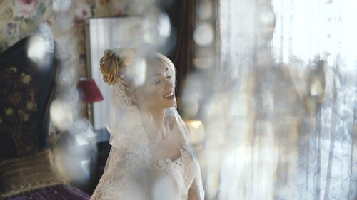 Wedding Couple Poses in Bedroom for Photosession