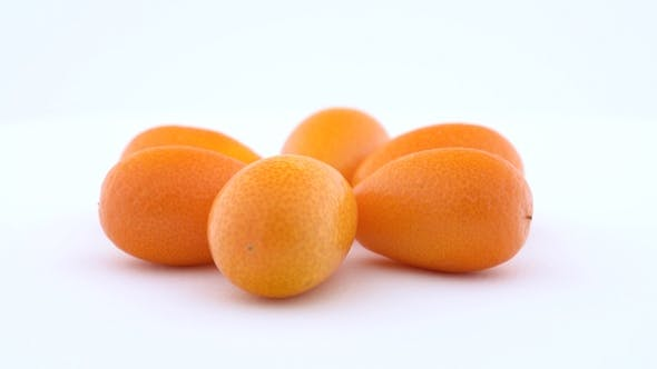 Thumbnail for Pile of Several Whole Kumquats. Rotating on the Turn Table. Isolated on White Background. Side View