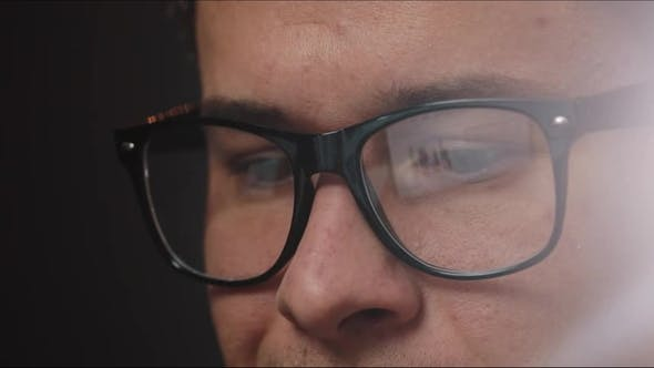 Thumbnail for Man's Eyes in Glasses while He Works at the Laptop in Office
