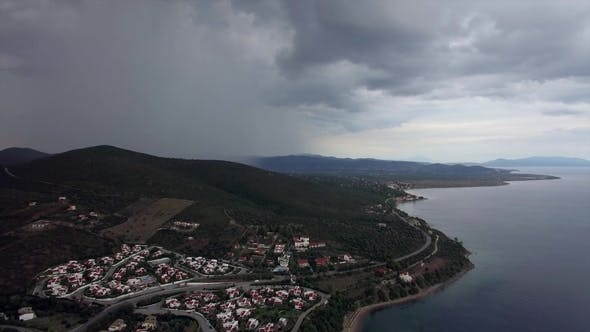 Thumbnail for Aerial View of Sea and Coast with Houses on Overcast Day. Trikorfo Beach, Greece