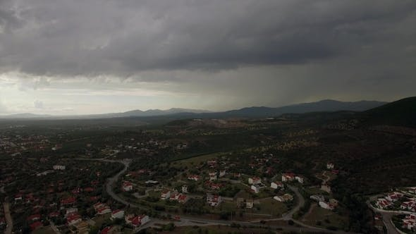 Thumbnail for Drone Flying and Descending Over Town, View To Cottages and Green Spaces, Greece