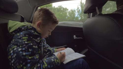 Child Solving Logic Chess Puzzles in the Car
