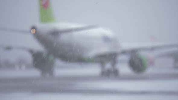 Thumbnail for Blur of Airplane Driving on the Landing Strip,