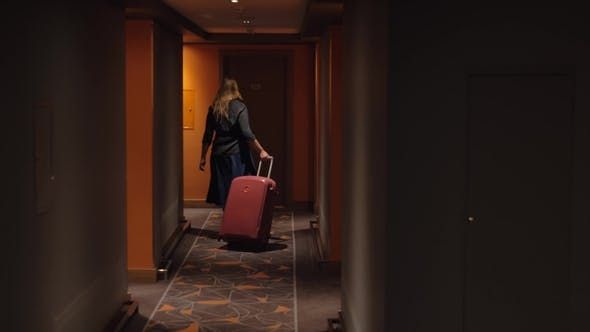 Cover Image for Woman Settling in Hotel Room