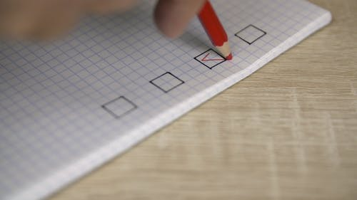 Red Checkmark Putting Into Check List in Copybook