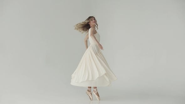 Thumbnail for Lightness, Beauty and Grace of a Young Girl Dancing Ballet. A Ballerina in Beige Pointe Shoes and a