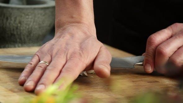 Thumbnail for Chef Preparing Garlic