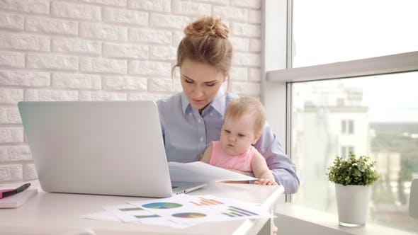 Thumbnail for Woman with Baby Not Concentrated at Work. Business Mother Looking Documents