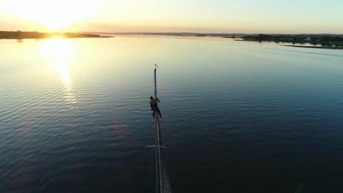Sailor Climbing Mast