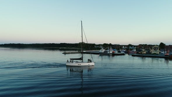 Sailboat Returning To Dock