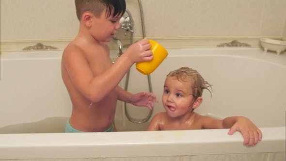 Thumbnail for Litttle Boy Washing His Younger Brother in a Bath