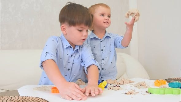 Thumbnail for Two Little Boys Playing with Dough and Learning How To Bake