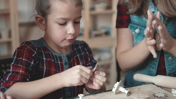 Thumbnail for Small Serious Girl Makes a Clay Craft from a Pottery Lesson