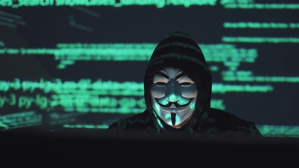 Thumbnail for Robber in the Background Running Program Code. Hacker in the Mask Hacks the Program. the Digital