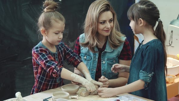 Thumbnail for Mother And Two Daughters in a Pottery Class