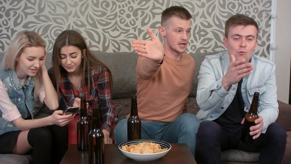 Thumbnail for Group of Friends Watching Sport Game on TV at Home and Reacting To a Game