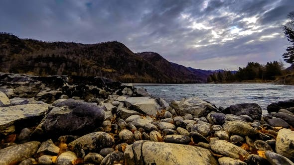Thumbnail for River Near Mountain Forest. Huge Rocks and Fast Clouds Movenings