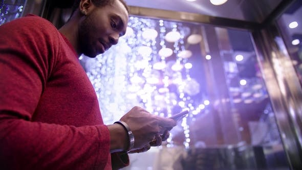 Thumbnail for African American Man Using Business App on Smart Phone