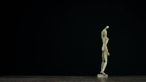Thumbnail for Wooden Figure Dummy in Studio on Black Background